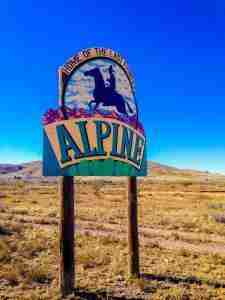 alpine texas home of the last frontier sign